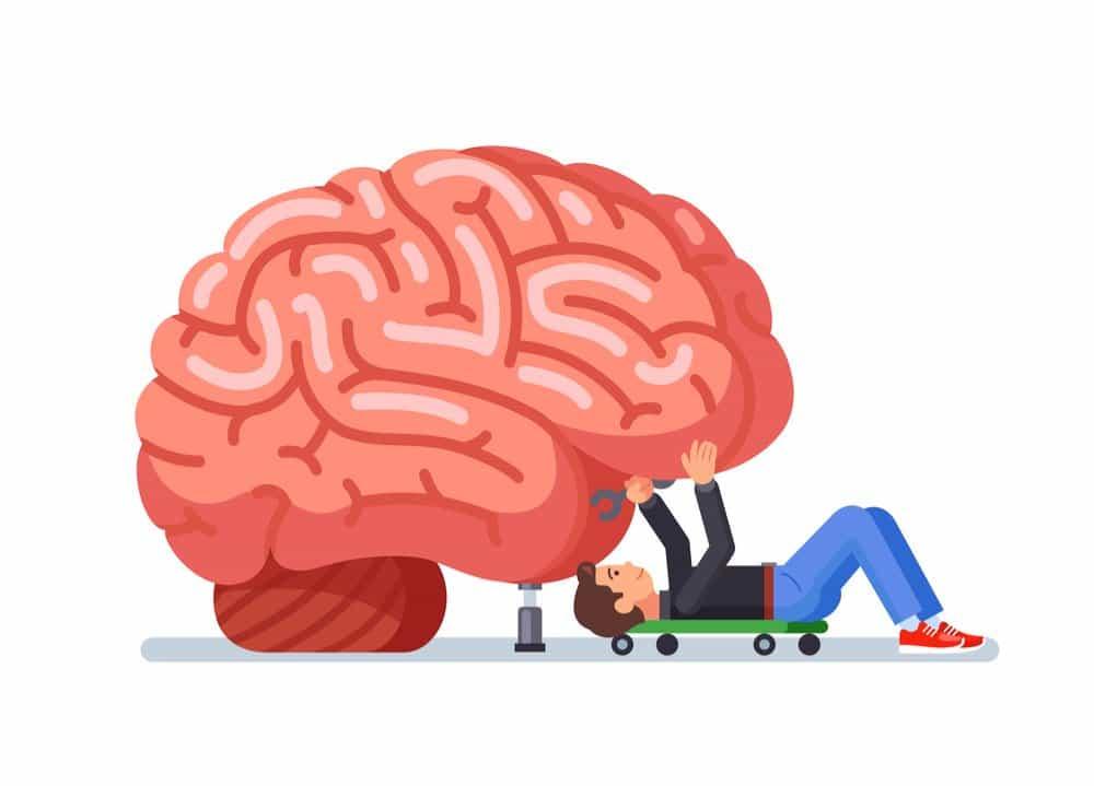 homem consertando um cérebro como se fosse um carro